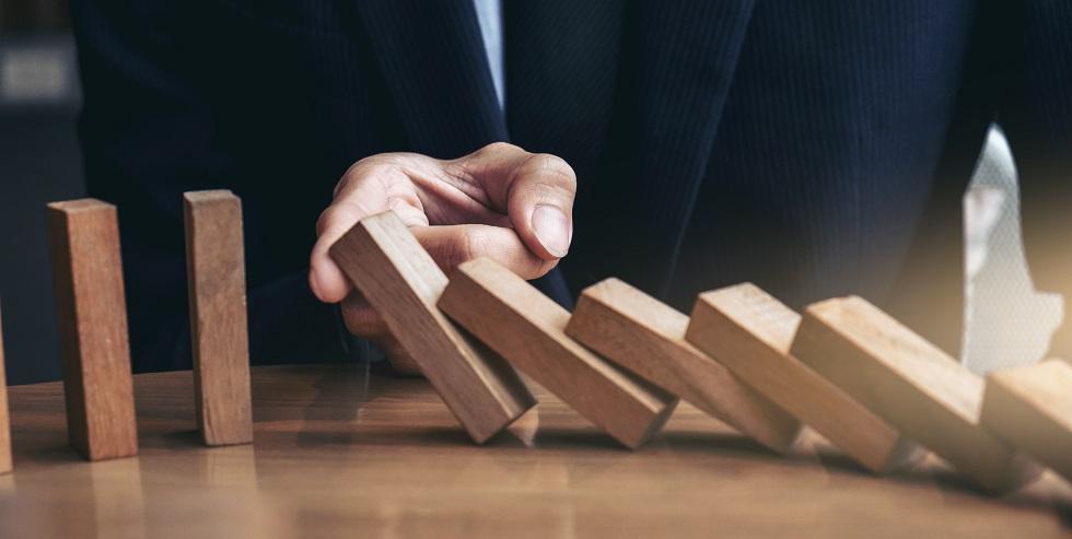 Mediatiors finger stops domino fall image