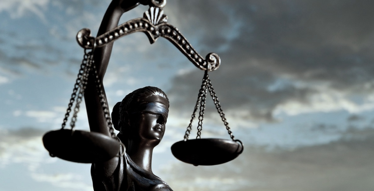 Themis holds the scales of justice
