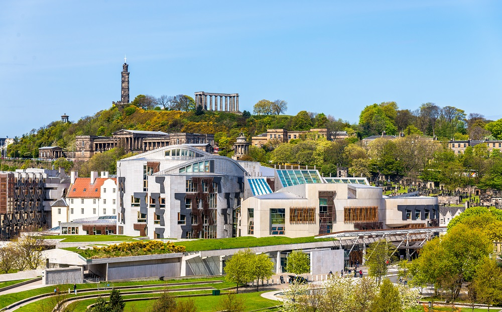 view of Scottish Parliament building with Calton Hill background