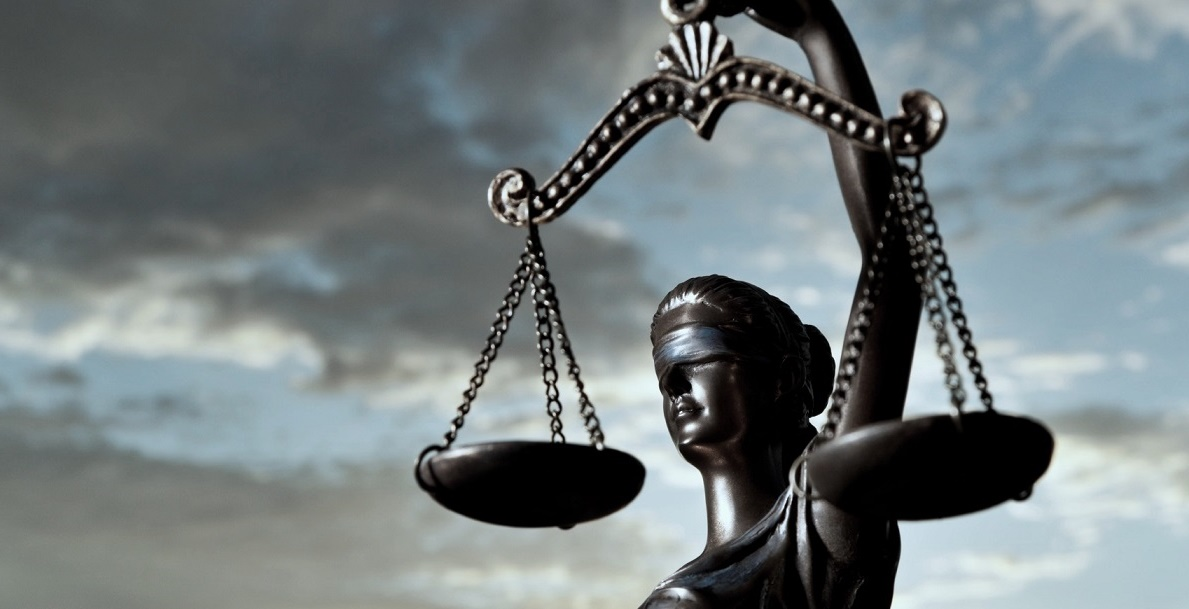 Blind folded Themis statue holding he scales of justice